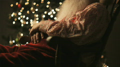 Santa Claus sitting in a rocking chair asleep - stock footage