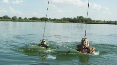 Dad wakeboarding with two daughters Stock Footage