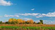 Countryside landscape panning - clouds, blue sky, autumn forest Stock Footage