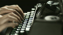 fingers typing on the keyboard of an old-fashioned typewriter - stock footage