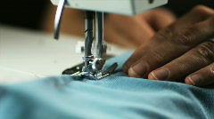 CU Woman using sewing machine. Stock Footage