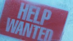 "CU TD ""Help wanted"" signboard frozen in ice block. Stock Footage"