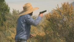 A Cowboy in a Gun Fight Shooting Over A bush 3 Stock Footage