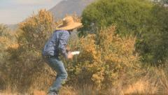 A Cowboy in a Gun Fight Shooting Over A bush 4 Stock Footage