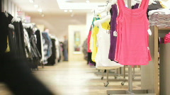 Clothes on hangers in a store Stock Footage