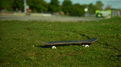 Skateboard in the grass Stock Footage