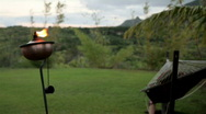 Stock Video Footage of Tiki Torch & Hammock