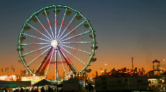 Stock Video Footage of Carnival Ferris wheel against bright sunset