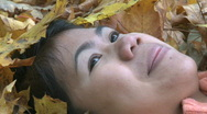 Stock Video Footage of Filipino woman and autumn colored leafs