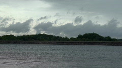 Summer Timelapse 06 Dark clouds over lake shore - stock footage