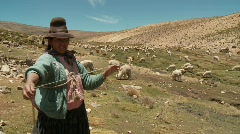 Woman with hat from Peru spinning Alpaca Wool, South America Stock Footage