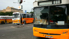 Old orange buses in the old bus terminus at Valetta Malta Stock Footage