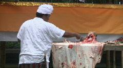 Balinese man salts cow hide Stock Footage