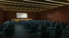 A conference hall with a white screen closing.  - stock footage