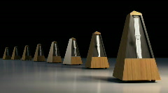 A line of ticking metronomes.  - stock footage