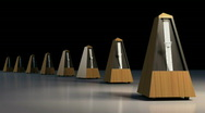 Stock Video Footage of A line of ticking metronomes.