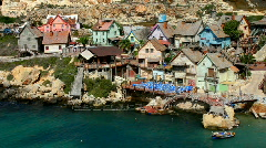 Timber houses of Popeye village in Anchor Bay Malta  Stock Footage