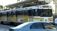 Stock Video Footage of Metro Rail Commuter Train In Transit Mall 1