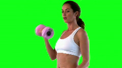 Athletic female exercising with dumbells Stock Footage