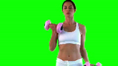 Attractive woman doing exercise with dumbells Stock Footage