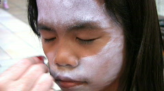 Applying Face Paint - stock footage