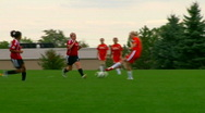Girls soccer teams passing ball back and forth Stock Footage