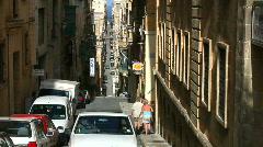 Narrow street with steep hills in Valetta Malta - stock footage