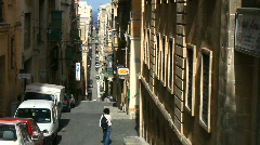Narrow street with steep hills in Valetta Malta Stock Footage