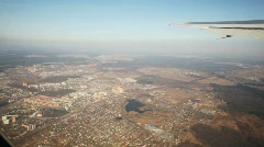 Top view at city through window of flying aircraft Stock Footage