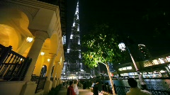 People in Dubai city during fountains show in Dubai, UAE Stock Footage