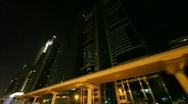 Stock Video Footage of illuminated skyscrapers in night Dubai city