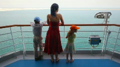 Mother with son and daughter stands on deck of cruise ship Stock Footage