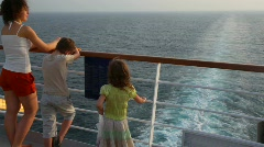 Mother with son and girl stands on deck of ship Stock Footage