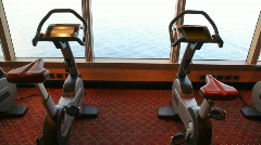 Exercise bicycles in gym of cruise ship Stock Footage