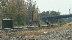 Girls walking on RR tracks Stock Footage