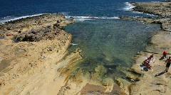 Stone shoreline at  Sliema Malta Stock Footage