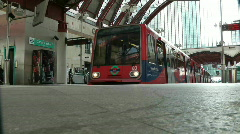 Docklands Light Railway driverless train pulling out of canary wharf DLR Stock Footage
