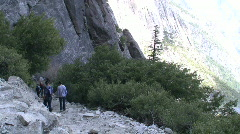 Hikers & Upper Falls Wide Tilt Up Stock Footage