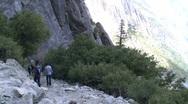 Stock Video Footage of Hikers & Upper Falls Wide Tilt Up