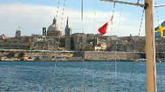 Malta flag and St Paul's cathedral Valetta from Sliema - stock footage