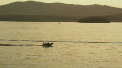 Motorboat on Scenic Lake Pend Oreille at Sunset 75 Stock Footage
