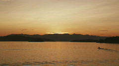 Motorboat on Scenic Lake Pend Oreille at Sunset 102 Stock Footage