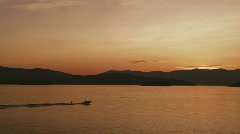 Motorboat on Scenic Lake Pend Oreille at Sunset 104 Stock Footage