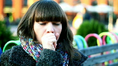 Sick woman coughing, outdoors Stock Footage