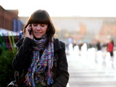Young woman talking on cellphone in urban environment  Stock Footage