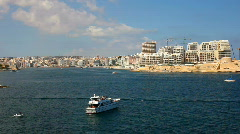 Boats in front of high rise development blocks at Sliema Stock Footage