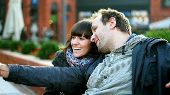 Happy couple in the city taking photo with cellphone  - stock footage