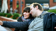 Stock Video Footage of Happy couple in the city taking photo with cellphone