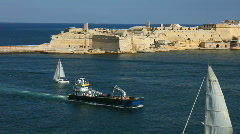 Ships and boats passing Ricasoli Point at the entrance to Grand Harbour Valetta Stock Footage