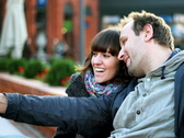 Happy couple in the city taking photo with cellphone  Stock Footage